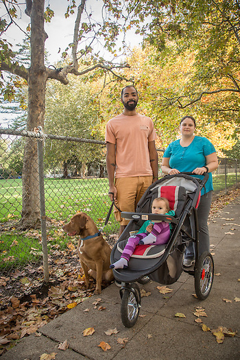 """If I could change one thing in the world...I would rather see people willing to listen than and less willing to act.""   -Ian Brooks with his wife, Megan,  one year old daughter, Remy, and rescue dog, Bowie, on Cedar Street in Calistoga. (Clark James Mishler)"
