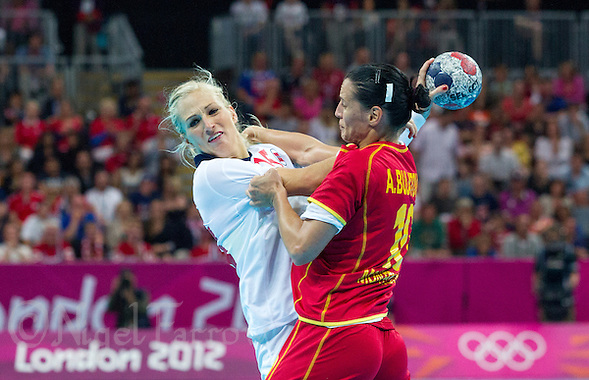 11 AUG 2012 - LONDON, GBR - Linn Jørum Sulland (NOR) (left) of Norway finds her path to goal blocked by Andjela Bulatovic (MNE) of Montenegro during the women's London 2012 Olympic Games handball final at the Basketball Arena in the Olympic Park, in Stratford, London, Great Britain (PHOTO (C) 2012 NIGEL FARROW) (NIGEL FARROW/(C) 2012 NIGEL FARROW)