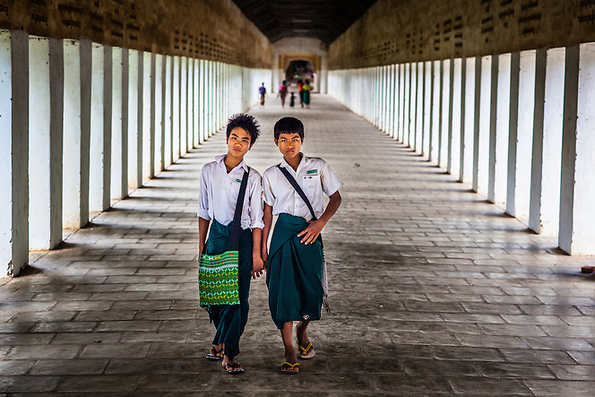 School boys walk through the Shewzigon Temple, Bagan, Myanmar (Quinn Ryan Mattingly)