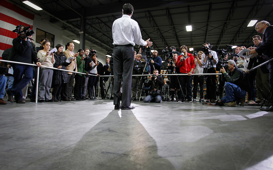MItt Romney takes questions from the media following a town hall meeting to discuss jobs and the economy at Diamond V, an animal nutrition company in Cedar Rapids, Iowa on Friday, December 9, 2011. (Christopher Gannon/MCT) (Christopher Gannon)