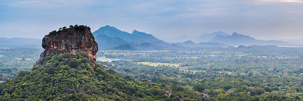 Panoramic photo of Sigiriya Rock Fortress, seen from Pidurangala Rock, Sri Lanka, Asia. This is a panoramic photo of Sigiriya Rock Fortress, seen from Pidurangala Rock, Sri Lanka, Asia. Sigiriya Rock Fortress, located in the 'cultural triangle' is the most popular tourist attraction in Sri Lanka and Pidurangala Rock offers an extremely impressive, panoramic view. It is hard to believe that Sigiriya Rock Fortress used to be the inside of a volcano.
