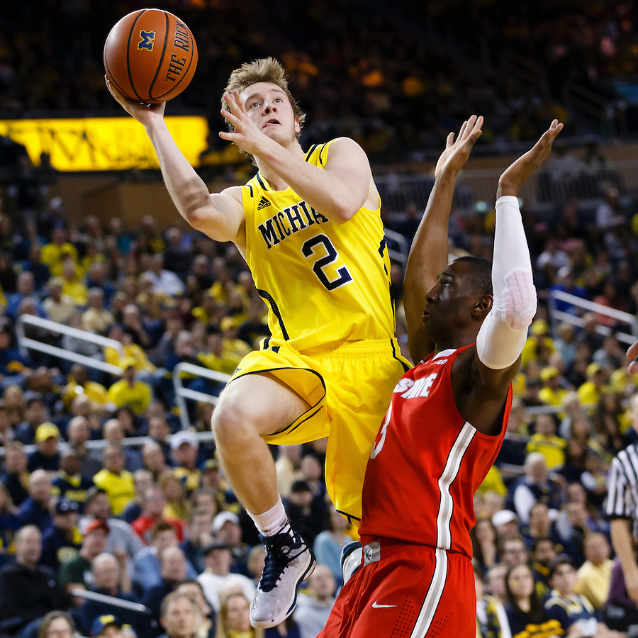 Feb 22, 2015; Ann Arbor, MI, USA; Michigan Wolverines guard Spike Albrecht (2) looks to shoots the ball over Ohio State Buckeyes guard Shannon Scott (3) in the first half at Crisler Center. Mandatory Credit: Rick Osentoski-USA TODAY Sports (Rick Osentoski/Rick Osentoski-USA TODAY Sports)