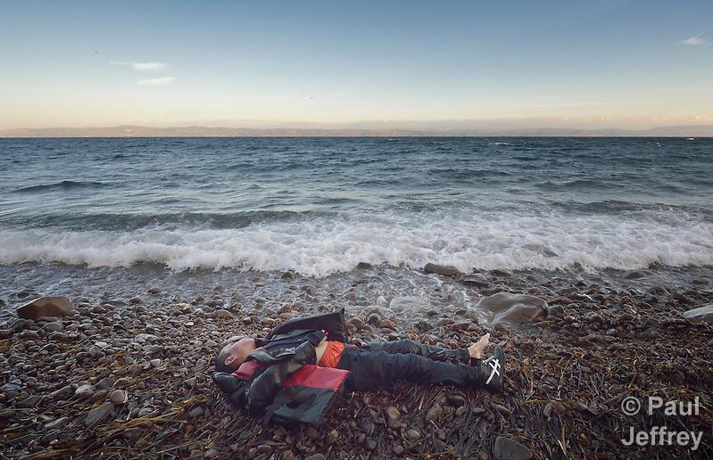 The body of a refugee child lies on a beach on the Greek island of Lesbos on November 1, 2015. The body appeared to be that of an Afghan boy of about 8 years of age. Thousands of refugees have died this year attempting to cross the Aegean from Turkey to Greece. Fleeing violence in Syria, Iraq, Afghanistan and elsewhere, most are on their way toward western Europe. (Paul Jeffrey)