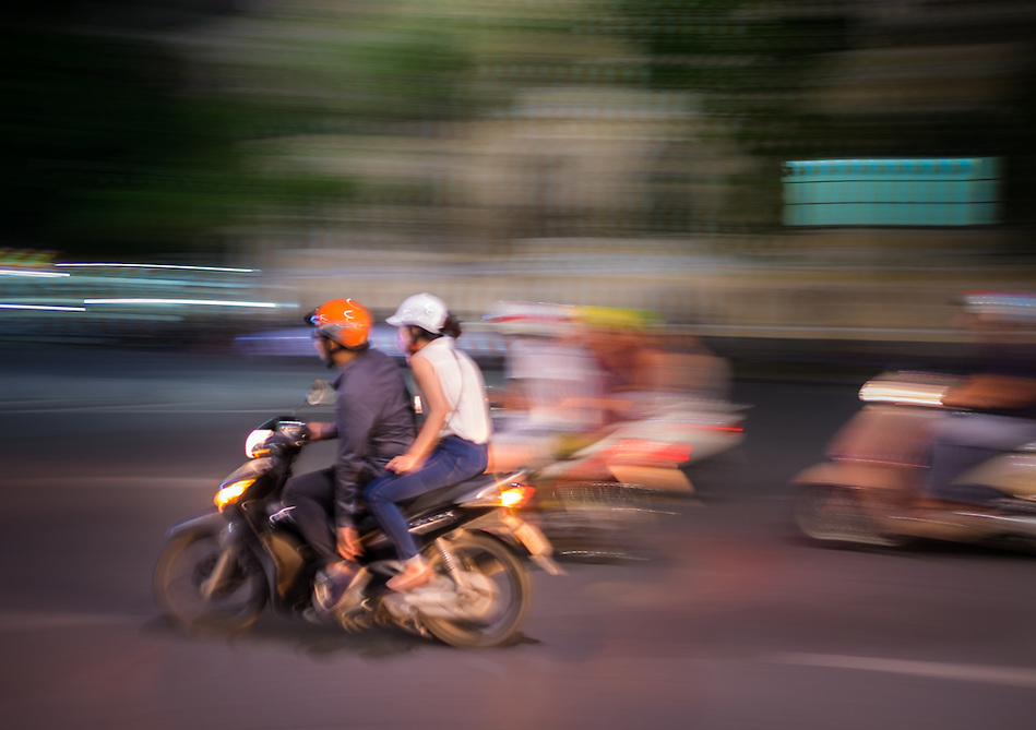 HANOI, VIETNAM - CIRCA SEPTEMBER 2014:  Motorbike rushing in the streets of the Old Quarter at night in Vietnam. (Daniel Korzeniewski)
