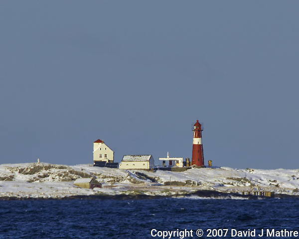 Lighthouse from the Deck of the Hurtigruten MV Kong Harald while Traveling to from Bergen to Alesund. Image taken with a Nikon D2xs and 80-400 mm VR lens (ISO 200, 400 mm, f/9.5, 1/350 sec). (David J Mathre)