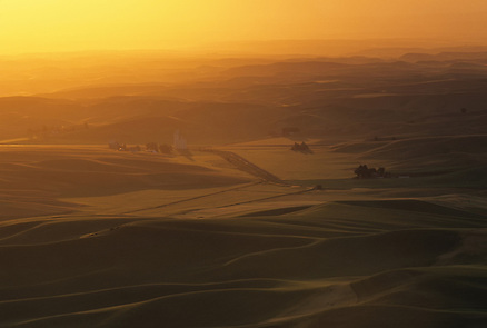 Warm orange light fills the air as the sun falls below the horizon on a dust-filled day in the Palouse of Eastern Washington State. (Benjamin Chase / Ben Chase Photography)