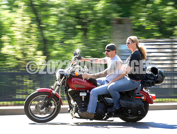 NEW HOPE, PA - JUNE 02:  An unidentified couple rides a motorcycle on Main Street on a warm afternoon June 2, 2014 in New Hope, Pennsylvania.  The temperature reached 82 degrees in New Hope and is expected to remain in the mid-80's for the next few days. (Photo by William Thomas Cain/Cain Images) (William Thomas Cain)