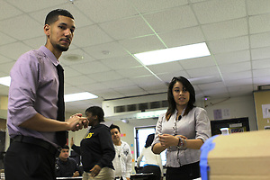 Teacher Justin Taplet and student Deysi Marquez view one of the early prototypes (Houston Independent School District)