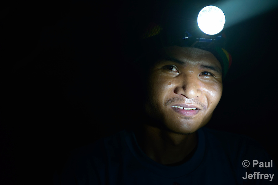A gold miner inside a mine in Pamintaran, a remote gold mining community near Maragusan on the Philippines' southern island of Mindanao. The site has become a focal point of an international struggle between small scale miners and large international mining corporations..