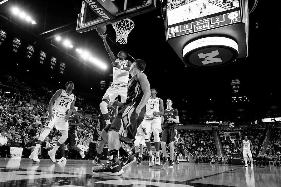 Nov 13, 2015; Ann Arbor, MI, USA; Michigan Wolverines guard Caris LeVert (23) goes to the basket against Northern Michigan Wildcats at Crisler Center. Mandatory Credit: Rick Osentoski-USA TODAY Sports (Rick Osentoski/Rick Osentoski-USA TODAY Sports)