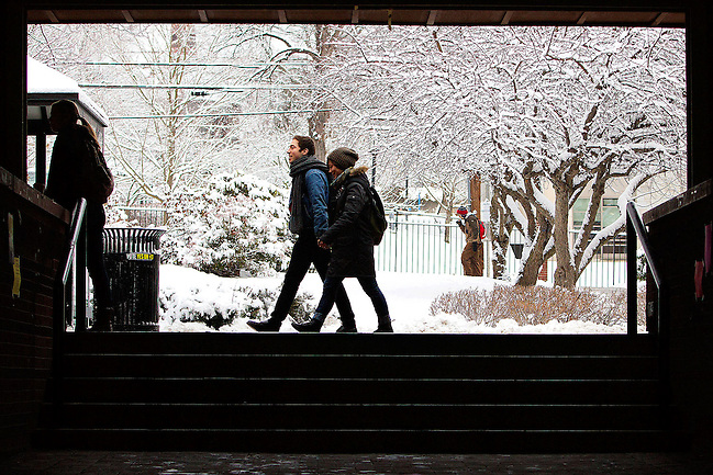 01/16/2013 -- SOMERVILLE, Mass. -- Students walk through the snow-covered campus of Tufts University on the first day of the spring semester on Jan. 16, 2013. (Kelvin Ma/Tufts University) (©2013 Trustees of Tufts College)