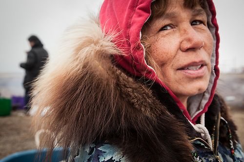 Doris Kubanyi, a resident of Fairbanks, visits her mother's village during Unagsiksiksauq (Clan Boat Celebration), Qagruq (Whaling Feast), Point Hope, The Purchase Centennial Poject (Clark James Mishler)