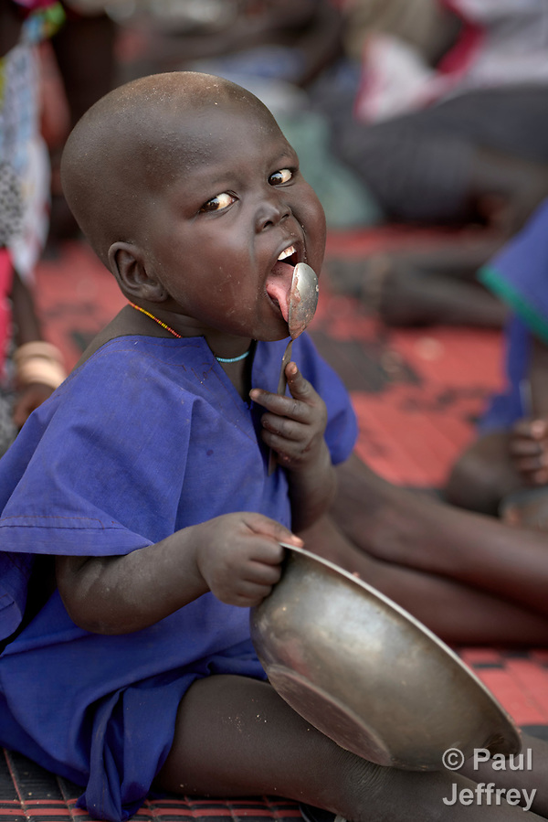 A child eats in an emergency feeding program for malnourished children at the Loreto Girls School in Rumbek, South Sudan. The school, run by the Institute for the Blessed Virgin Mary--the Loreto Sisters--of Ireland, has opened its compound to hundreds of nearby villagers facing hunger because of ongoing conflict and climate change. (Paul Jeffrey)