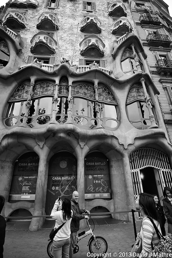 Xavi on His Bicycle in Front of Casa Batlló in Barcelona, Spain. Image taken with a Nikon 1 V1 and 6.7-13 mm VR lens (ISO 160, 6.7 mm, f/4, 1/500 sec). (David J Mathre)