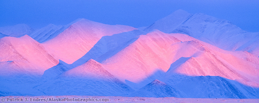 Pink alpenglow on the philip smith mountains of the Brooks Range, Arctic, Alaska. (Patrick J. Endres / AlaskaPhotoGraphics.com)