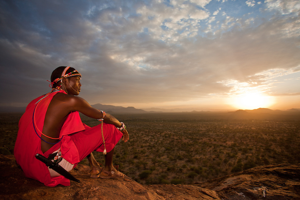 A Samburu Moran surveys a vast landscape unscarred by industrial development in northern Kenya (Robin Moore)