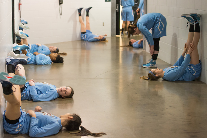 4/4/16 – Indianapolis, IN – The women's basketball team stretches below Bankers Life Fieldhouse before the NCAA Div. III women's basketball championship on Monday, April 4, 2016. (Evan Sayles / The Tufts Daily) (Evan Sayles / The Tufts Daily)