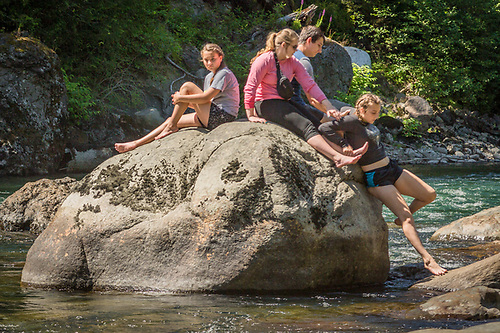 Kids climb on  rock on Washington's Snoqualmie River. (Clark James Mishler)