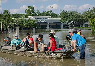Susan Keays, 49, guides a boat of volunteers as they leave to assist trapped families along a flooded Memorial Boulevard, Aug. 31, 2017, in Houston, Texas. Volunteers have streamed into Houston all week, sacrificing their time, money, and safety to help those affected by heavy flooding following Hurricane Harvey. (Photo by Carmen K. Sisson) (Carmen K. Sisson/Cloudybright)