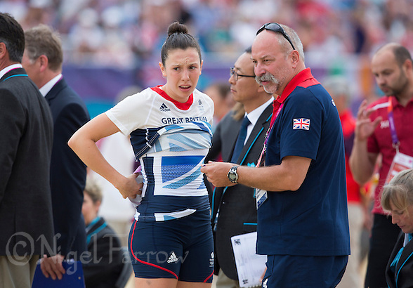 12 AUG 2012 - LONDON, GBR - Samantha Murray (GBR) (left) of Great Britain talks with coach Istvan Nemeth before the start of the women's London 2012 Olympic Games Modern Pentathlon Combined Event in Greenwich Park, Greenwich, London, Great Britain .(PHOTO (C) 2012 NIGEL FARROW) (NIGEL FARROW/(C) 2012 NIGEL FARROW)
