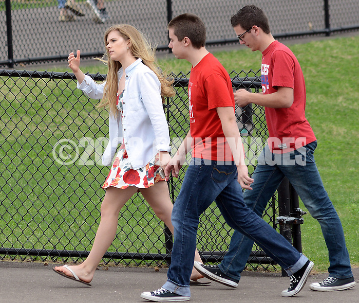 SOUDERTON, PA - APRIL 14:  Students exit the football field after a bomb threat forced the evacuation of Souderton High School April 14, 2014 in Souderton, Pennsylvania. (Photo by William Thomas Cain/Cain Images) (William Thomas Cain)