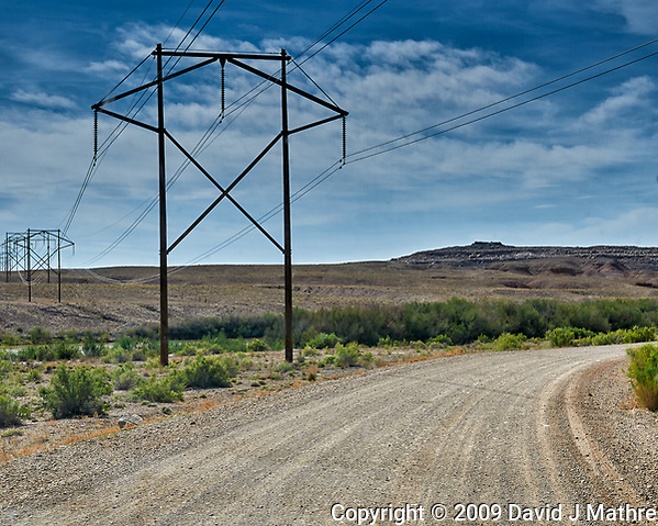 Power Lines Crossing the Road to Crystal Geyser Near Green River, Utah. Image taken with a Nikon D300 camera and 18-200 mm VR lens (ISO 200, 32 mm, f/10, 1/400 sec). (David J Mathre)