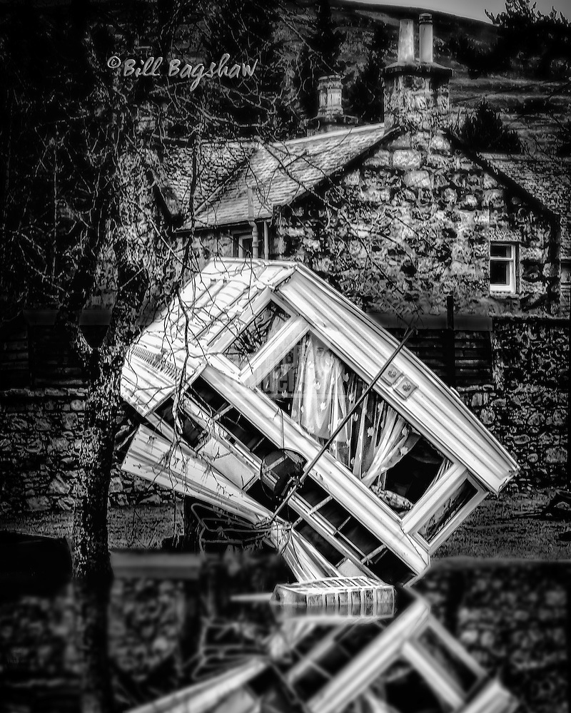 Reflection on a dark day. Ballater flooding 2015. Washed up caravan reflected in flood water (Bill Bagshaw/M. Williams)