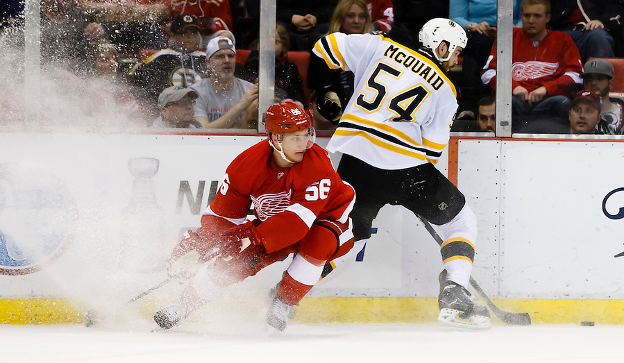 Apr 2, 2015; Detroit, MI, USA; Detroit Red Wings left wing Teemu Pulkkinen (56) and Boston Bruins defenseman Adam McQuaid (54) battle for the puck in the first period at Joe Louis Arena. Mandatory Credit: Rick Osentoski-USA TODAY Sports (Rick Osentoski/Rick Osentoski-USA TODAY Sports)