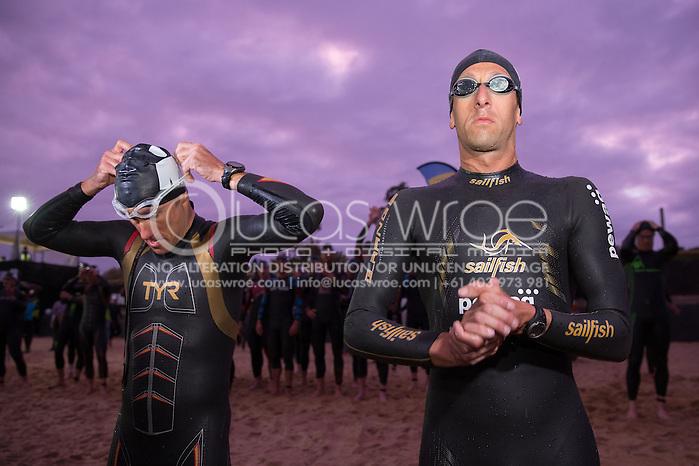 Craig Alexander (AUS) and Mario Vanhoenacker (BEL), March 23, 2014 - Ironman Triathlon : Swim Course. Ironman Melbourne Race Race, Frankston Swim Course/Transition, Melbourne, Victoria, Australia. Credit: Lucas Wroe (Lucas Wroe)
