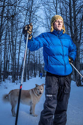 Small construction company owner, Cory Bernacchi with his dog, Teddy, on the Tony Knowles Coastal Trail near Westchester Lagoon, Anchorage (Clark James Mishler)