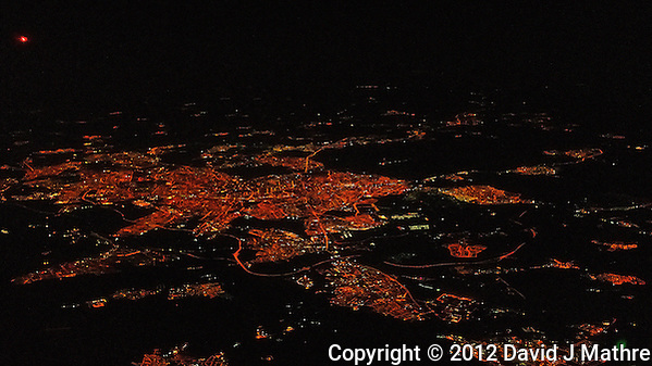 Early Morning (4 AM) View of Madrid from 30,000 ft. Lufthansa flight from Casablanca to Frankfurt. Image taken with a Leica X2 camera (ISO 6400, 24 mm, f/2.8, 1/60 sec). (David J Mathre)