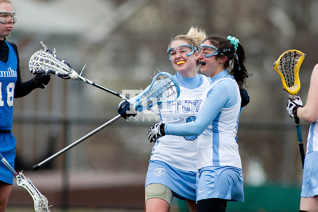 03/10/2012- Medford, Mass. - Tufts attack Kelly Hyland, A12, left, hugs Tufts attack Lara Kozin, A12, after Kozin scored in Tufts 8-7 season opening win over Hamilton on Mar. 10, 2012. (Kelvin Ma/Tufts University)