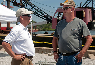 Magnolia Springs Mayor Charles Houser and Volunteer Fire Department Chief Jamie Hinton stand in front of a spud barge June 11, 2010 in Magnolia Springs, Ala. Houser and Hinton are leading the town in a fight to protect the area from encroaching oil by blocking the entrance to Weeks Bay with barges and layers of containment boom following the Deepwater Horizon oil rig explosion and BP oil spill. (Photo by Carmen K. Sisson/Cloudbright) (Carmen K. Sisson/Cloudybright)