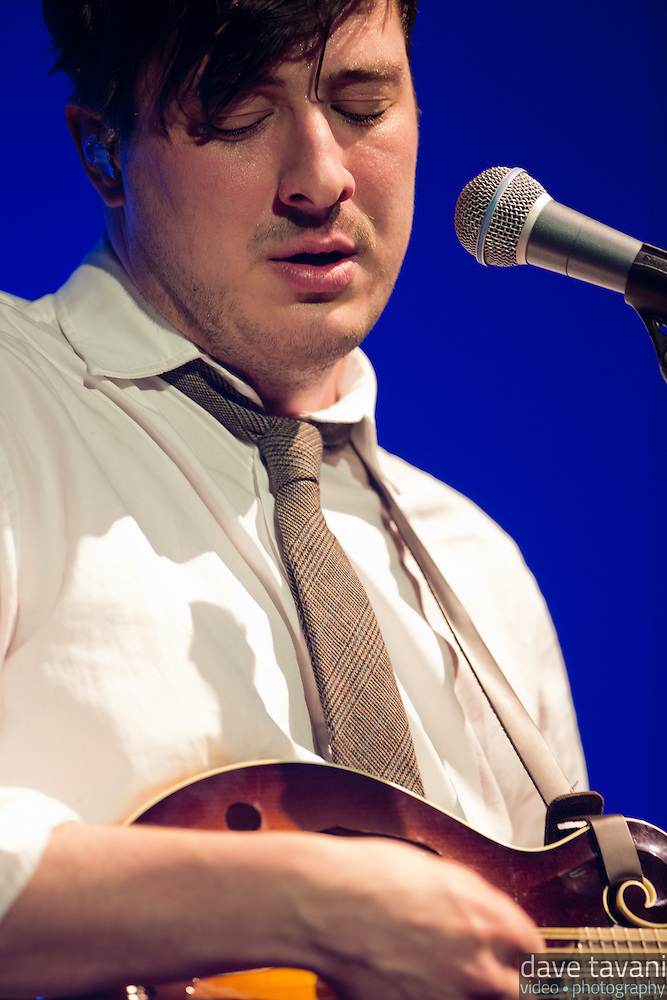 "Marcus Mumford strums the mandolin during a performance of ""Winter Winds"" at the Susquehanna Bank Center on February 16, 2013. (Dave Tavani)"