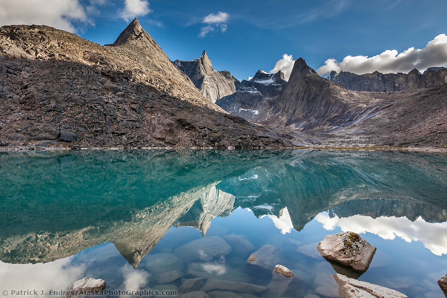Gates of the Arctic National Park photos: Dramatic granite spires of the Arrigetch Peaks reflect in the mirror calm mountain lake, Gates of the Arctic National Park, Alaska. (Patrick J Endres / AlaskaPhotoGraphics.com)