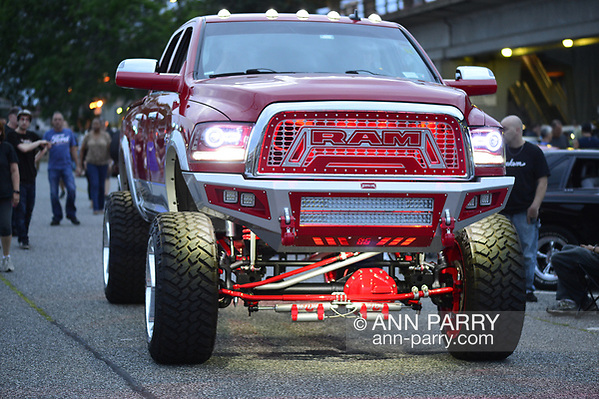 Bellmore, New York, USA. 11th August 2017. Red RAM lifted underlit truck drives past onlookers at the Bellmore Friday Night Car Show (Ann Parry/Ann Parry, ann-parry.com)