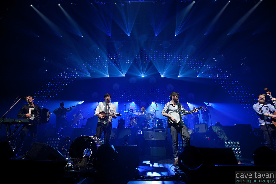 "Mumford & Sons (Ben Lovett, Marcus Mumford, Winston Marshall, and Ted Dwane) perform ""Winter Winds"" during a live concert at the Susquehanna Bank Center in Camden, New Jersey, February 16, 2013. (Dave Tavani)"