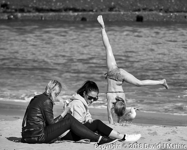 Acrobatics on the Beach. Afternoon Street Photography in Cascias. Image taken with a Nikon 1V3 camera and 70-300 mm VR telephoto zoom lens. (DAVID J MATHRE)