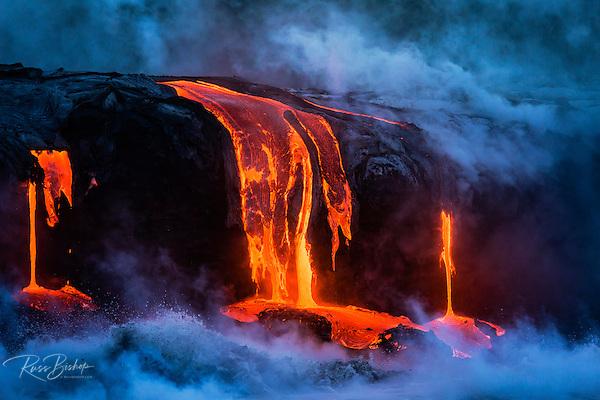 Lava flow entering the ocean at dawn, Hawaii Volcanoes National Park, The Big Island, Hawaii USA (© Russ Bishop/www.russbishop.com)