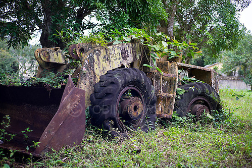 An abandoned bulldozer is gradually taken over by the jungle in Dois Rios on the island of Ilha Grande, Brazil. Photo by Andrew Tobin/Tobinators Ltd (Andrew Tobin/Tobinators)