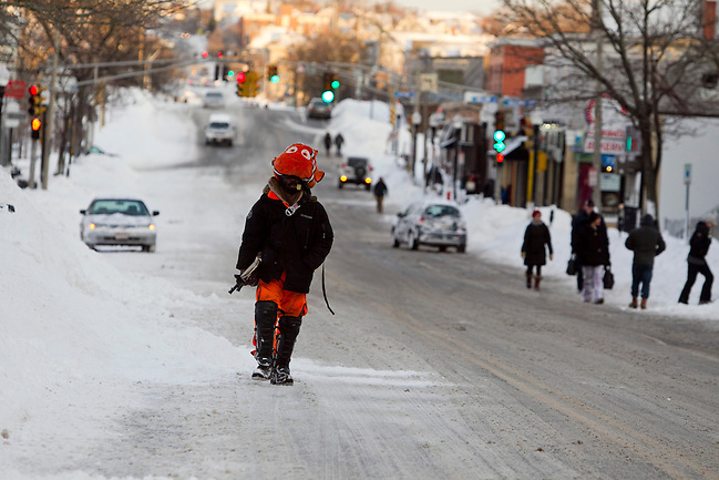 Kpafun (CQ), of Medford, Massachusetts, U.S., dressed as Nemo, the title character from the film Finding Nemo, walks along Broadway in Somerville, Massachusetts, U.S., after Winter Storm Nemo on Saturday, Feb. 9, 2013. Kelvin Ma/Bloomberg
