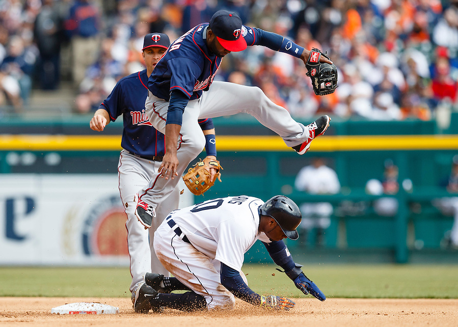 Apr 6, 2015; Detroit, MI, USA; Minnesota Twins center fielder Danny Santana (39) leaps over Detroit Tigers left fielder Rajai Davis (20) after he makes the throw to complete a double play as he slides into second base at Comerica Park. Mandatory Credit: Rick Osentoski-USA TODAY Sports (Rick Osentoski/Rick Osentoski-USA TODAY Sports)
