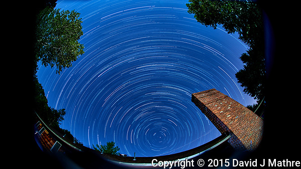 Startrails Looking North. Composite of 60 images taken with a Nikon D800 camera and 10.5 mm f/2.8 fisheye lens (ISO 100, 10.5 mm, f/4, 120 sec). Raw images processed with Capture One Pro with the composite processed using Phototshop CC Statistics/Maximum. (David J Mathre)
