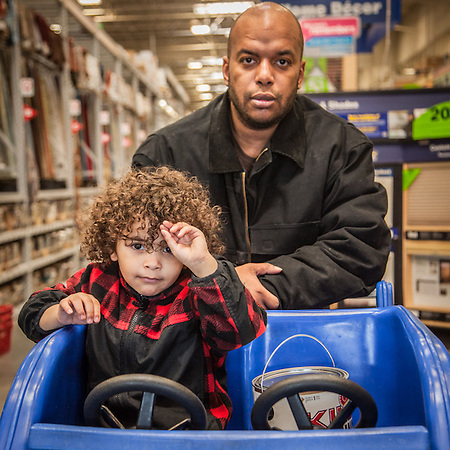 Johnny Degrate and his three year old son Jasantte at Lowes in mid town Anchorage.  degratejohnny02@gmail.com (© Clark James Mishler)