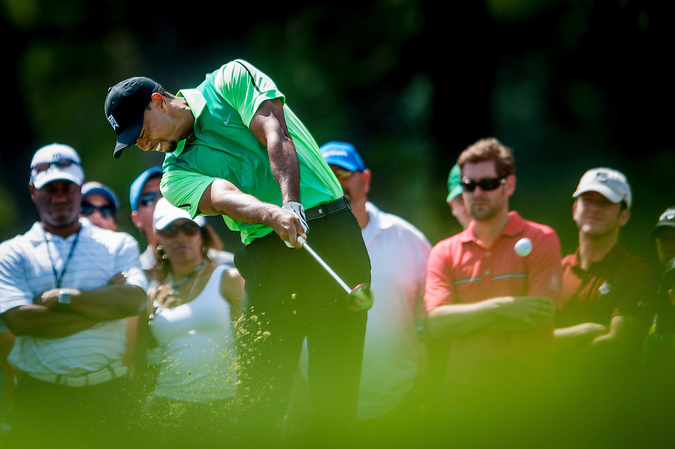 Tiger Woods tees off on the 2nd hole during the first round of the Quicken Loans National golf tournament on Wednesday at Congressional Country Club in Bethesda, Maryland. This marked  Woods' return to competition for the first time in three months after having surgery just a week before the Masters in April of this year. (Pete Marovich/Corbis)