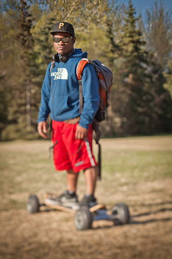 Long boarder, Isaiah Carson, near Westchester Lagoon, Anchorage (Clark James Mishler)