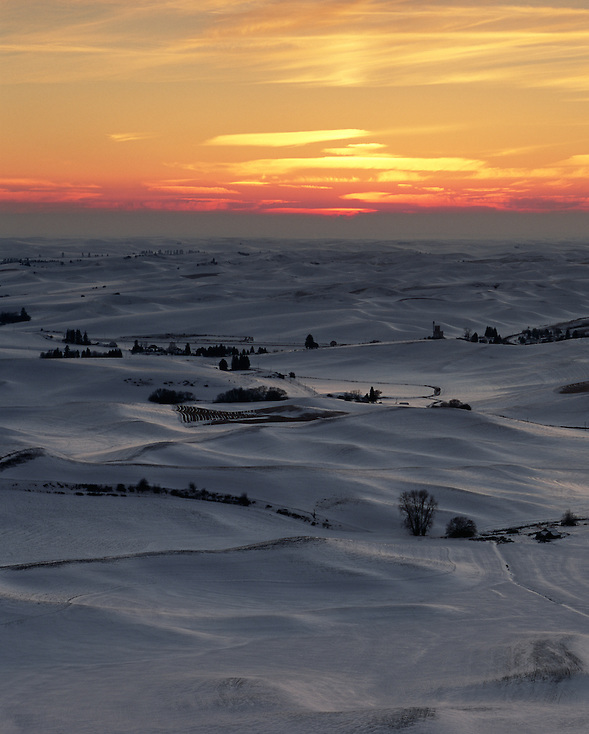 The snowy hills reflect the last light of the day as the sun sets over the Palouse of Eastern Washington State. (Benjamin Chase / Ben Chase Photography)