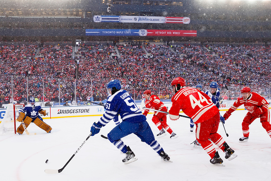 Jan 1, 2014; Ann Arbor, MI, USA; Toronto Maple Leafs defenseman Jake Gardiner (51) skates with the puck defended by Detroit Red Wings right wing Todd Bertuzzi (44) during the 2014 Winter Classic hockey game at Michigan Stadium. Mandatory Credit: Rick Osentoski-USA TODAY Sports (Rick Osentoski/Rick Osentoski-USA TODAY Sports)