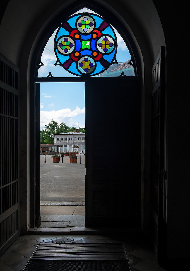 LATVIA, CESIS - CIRCA JUNE 2014: View of entrance and stained glass artwork of the St. John's Church in Cesis in Latvia. (Daniel Korzeniewski)