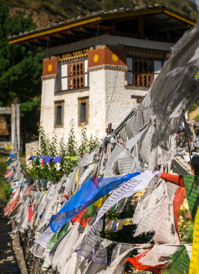 PARO, BHUTAN - CIRCA October 2014: Iron Chain Bridge and prayer flags at the Tachog Lhakhang Dzong (Daniel Korzeniewski)